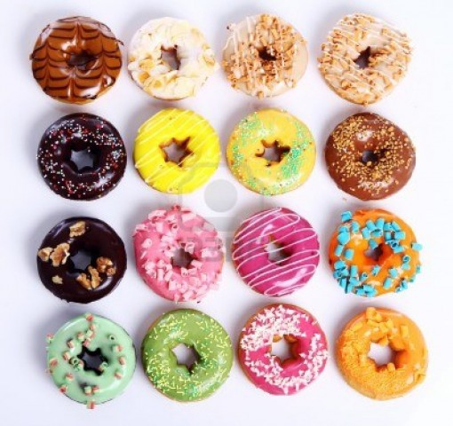 9000288-colorful-and-tasty-donuts-on-white-background